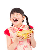 chinese new year. little girl showing  gold for luck.