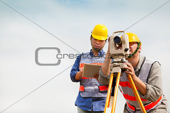 Surveyor engineer taking measurements
