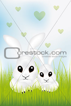 Adorable Easter rabbits in green grass