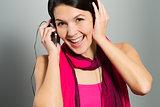 Beautiful trendy woman listening to music