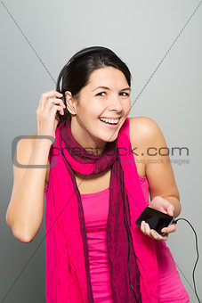 Beautiful vivacious woman listening to music