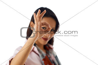 Portrait of asian woman showing ok sign at camera