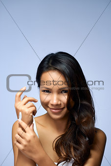 Asian girl using beauty cream and cosmetics