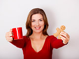Woman drinking coffee with cookies