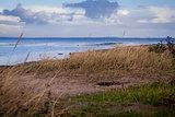 beautiful landscape in autum baltic see green field blue sky