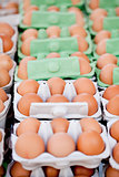 group of eggs in carton box closeup market outdoor