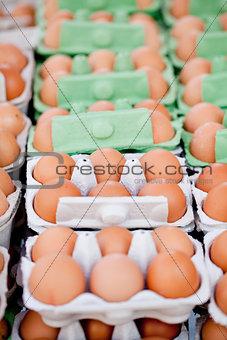 group of eggs in carton box closeup market outdoor