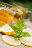 fresh tasty hot tea lemon and mint outdoor in summer