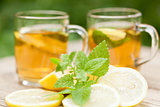 fresh tasty hot tea lemon and mint outdoor in summer