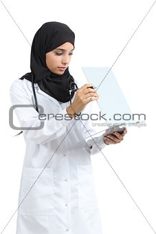 Arab doctor woman reading a clinical history
