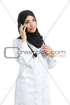 Arab doctor woman talking on the smart phone