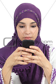 Arab woman writing a message addicted to the smart phone