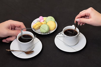 Couple drinking coffee with macaroon