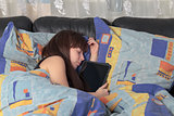 young girl asleep with a tablet laptop