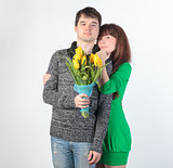 happy young couple with bouquet flowers