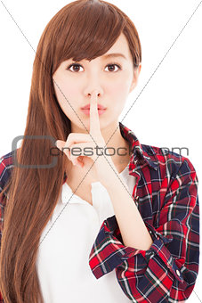 beautiful young woman with finger on lips