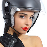 Sexy biker woman with an helmet and gloves