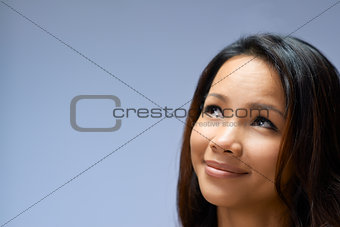 Portrait of Asian girl looking up and smiling