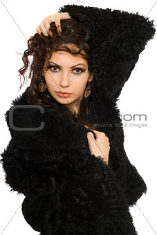 Portrait of attractive young brunette in black coat