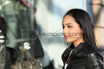Beautiful woman watching a storefront in the street