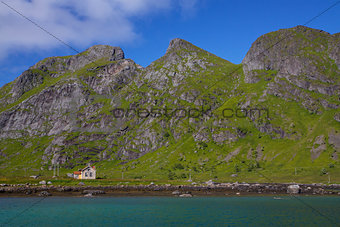 Abandoned house by fjord