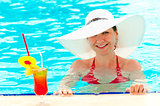 young girl in a white hat in the swimming pool