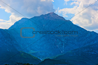 beautiful mountain peak in blue against the sky