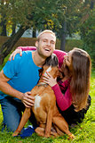 Happy Young Couple with Dog