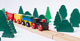 wooden toy train in rural landscape
