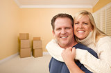 Happy Affectionate Couple in Room of New House with Boxes