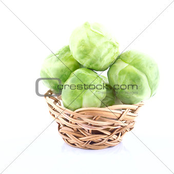 Tiny wicker with the raw Brussels sprout