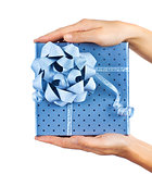 Female hands holding blue gift box