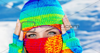 Close up on covered face with blue eyes