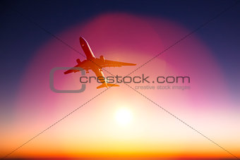 airplane with beautiful orange sunset background