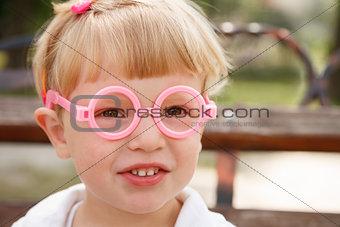little girl in glasses