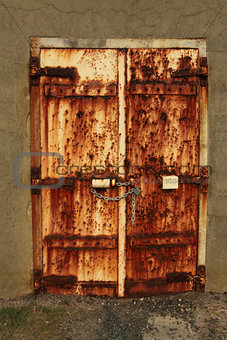 Rusty padlocked door