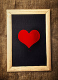 Heart on black board