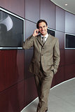 Businessman with mobile phone h