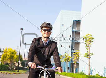 businessman riding a bicycle to workplace for protecting environ
