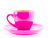 Beautiful colorful pink cup on plate isolated on white backgroun