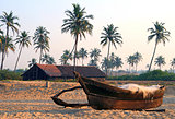 fishing boat on the sandy shore