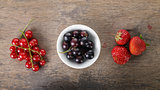 organic garden berries on old wood table