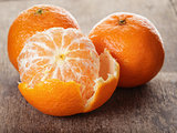 ripe tangerines closeup photo on wooden table
