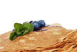 traditional homemade blinis or crepes with blueberries