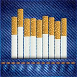 cigarettes on bllue jeans background