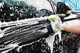 hands hold sponge  for washing car