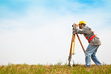 Surveyor engineer making measure on the field