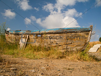 Old nautical vessel - abandoned on the dry land