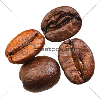 four roasted coffee beans