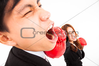 businesswoman hitting businessman isolated on white background